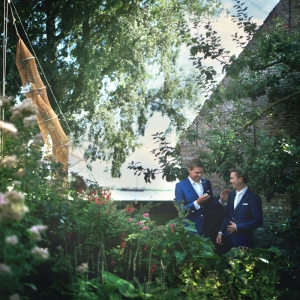 same gender marriage near Amsterdam. Portrait of two newlywed men near Amsterdam.
