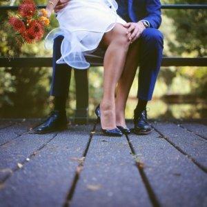 Wedding portrait on a bridge in an Amsterdam park.